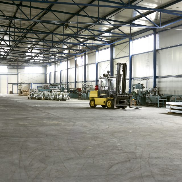 forklift in sheet metal production hall