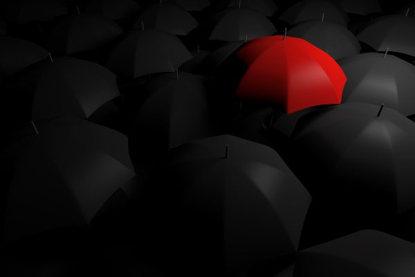 Standing out from the crowd, red umbrella